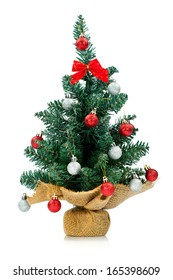 Small and lovely decorated Christmas tree isolated on white background.
