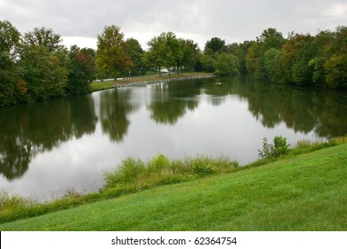 a small man-made lake in an affluent residential community