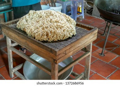 Small manufacturing facility making traditional puffed rice dessert treats.