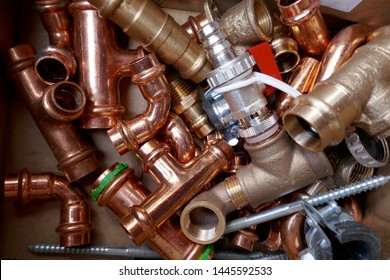 Small material for plumbers and heating installers. Copper, brass, steel, pipes, angles