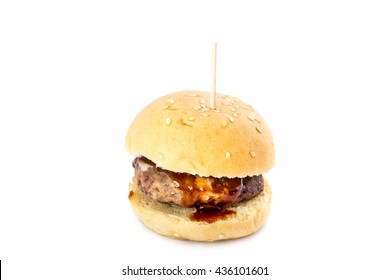 Small meat burger with barbecue sauce isolated on white background.