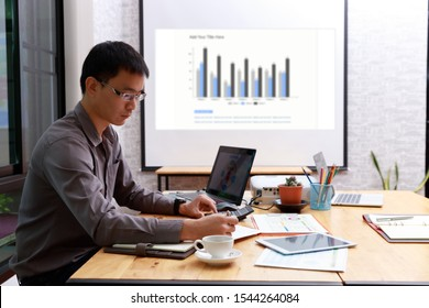 Small and Medium Enterprise Business concept of ,Businessman using calculator to calculate Assets Chart
