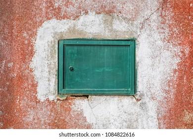 small metal gate on grunge wall