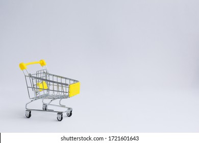 small metal grocery shopping cart, on a white background. Designer blank