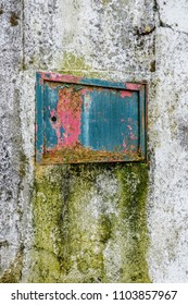 small metal open gate on grunge wall