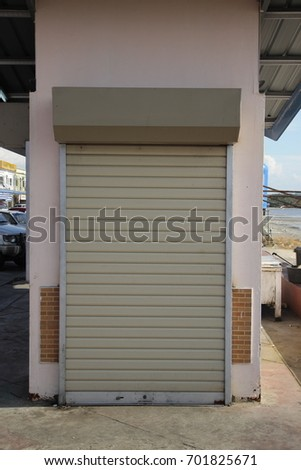 Small Metal Rolling Garage Door Stock Photo Edit Now 701825671