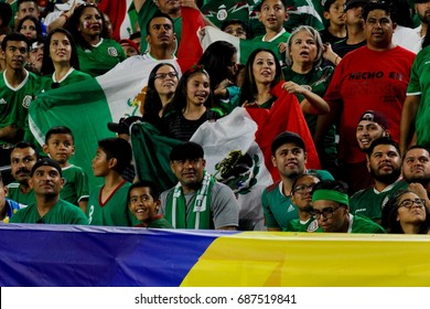Small Mexican family at University of Phoenix Stadium in Glendale, AZ to root for Mexico to beat Honduras July 20,17..