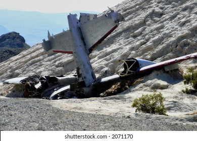 Small military plane set up as an accident in a desert junkyard