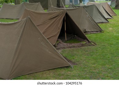 small military tents in a row
