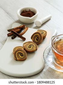 Small Mini Lapis Legit Roll, Delicious Traditional Cake from Indonesia with Spice and Cinnamon. White Background and White Choppingboard.