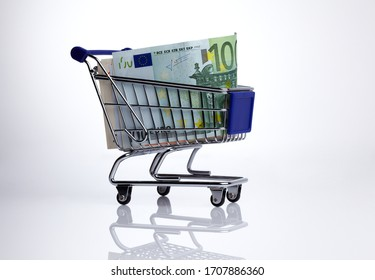 small miniature shopping trolley with euro banknotes