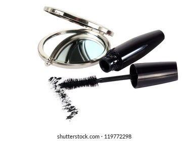 small mirror and ink for eyelashes on a white background