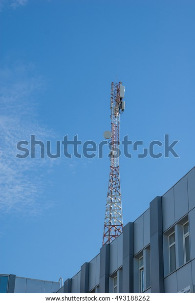A small mobile tower on the roof of the building.
