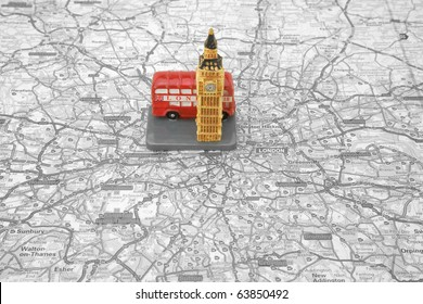 Small Model of a Red Bus and Big Ben on top of a Map of london