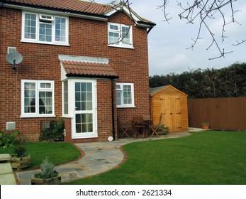 small modern english brick house and garden