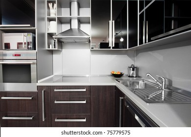 Small modern kitchen in black and wenge colors