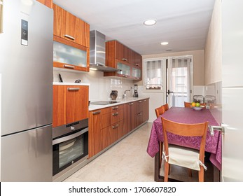 small modern kitchen with wooden furniture