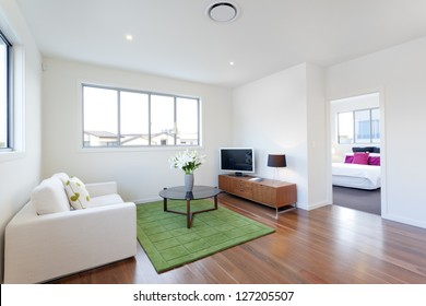 Small modern living room with TV and couch