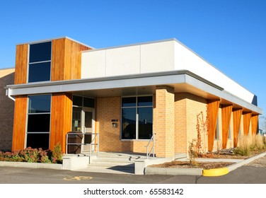 Small modern public office building mixing wood and brick material.