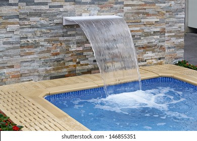 Small modern spa pool with water flow