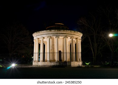Small monument inside a big park in Corfu city during night time