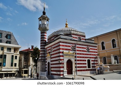 Small mosque with red and white color stripe in the center of Istanbul, Turkey