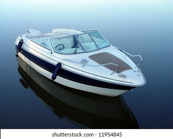 Small motor boat on quiet water