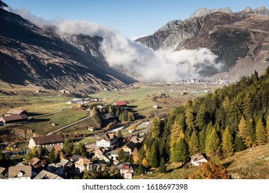 a small mountain settlement in Switzerland with wiev at the peak