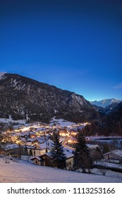 Small mountain village Filisur in Graubünden Switzerland during Night with moonlight in background