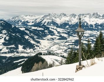 Small mountain village in a valley between frozen alps peaks. Kitzbuhel, Austria.