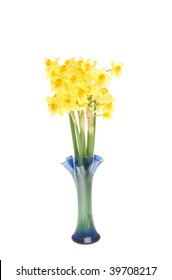 Small multi head daffodils in a blue glass vase