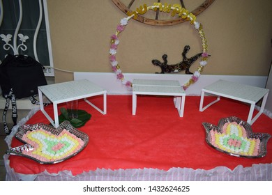 small multicolored marshmallow candies on a dish in the shape of a symbol hand, oriental hamsa, red tablecloth, traditional engagement dessert,hoop with a mikveh inscription