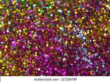 Small multicolored sequins as background, unfocused