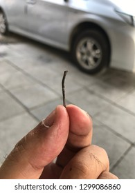 A small nail found embedded in the front tyre causing punctured and air leakage and reduce car's performance