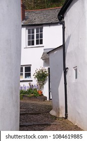 Small narrow cobblestone street and whit washed cottages in the small fishing village of Clovelly in Devon, England