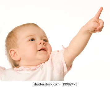 Small nice girl shows a finger upwards on a white background