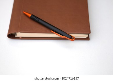 Small notebook and pen