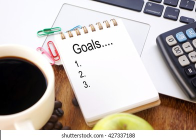 Small notebook with word Goals
