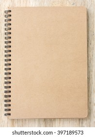 Small notepad on wood background