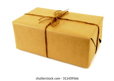 Small oblong package tied with string, isolated