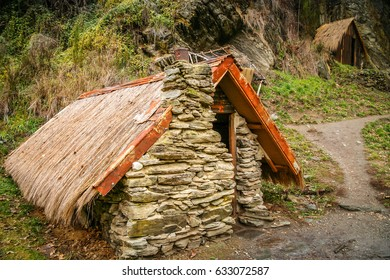 Small old home made from stones and rocks inhabited long time ago by Chinese workers in New Zealand
