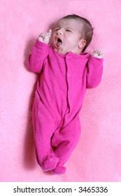 small one week old newborn baby expressions
