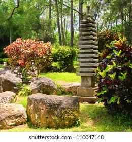 Small ornamental pagoda on a traditional japanese garden