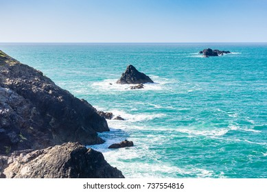 Small outcrops of rock in the crashing seas of the North Atlantic. Small islands of rock protrude from the tide frequently to catch out unwary boats and their crews.