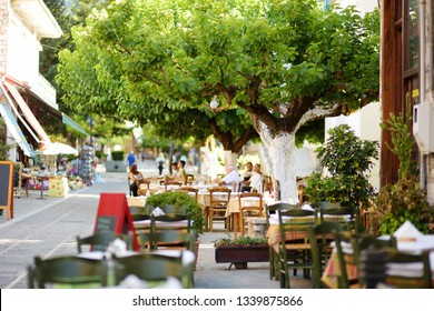Small outdoor restaurants and cafes at the pedestrian area at center of Kalavryta town near the square and odontotos train station, Greece.