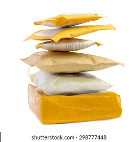 Small Packet. Paper envelopes and parcels stacked in a pile. Delivery online store. Object isolated on white.