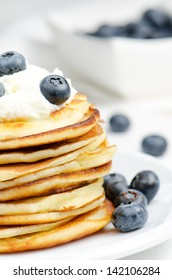 Small pancakes with cream and blueberry