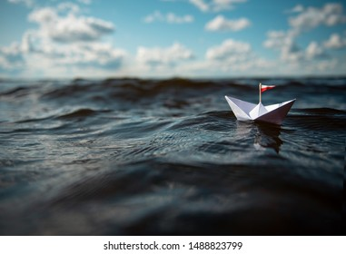 Small Paper Boat in Big Waves