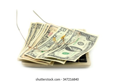 small paper dollars, glasses and calculator