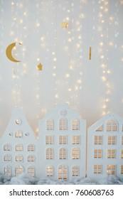 small paper village near Christmas lights